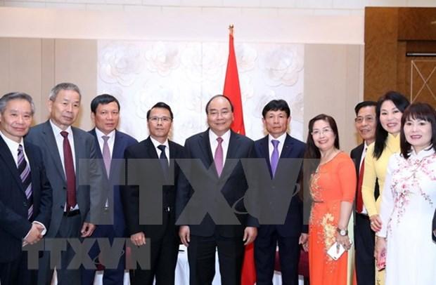 Premier vietnamita insta a asistencia mutua entre compatriotas en el extranjero hinh anh 1