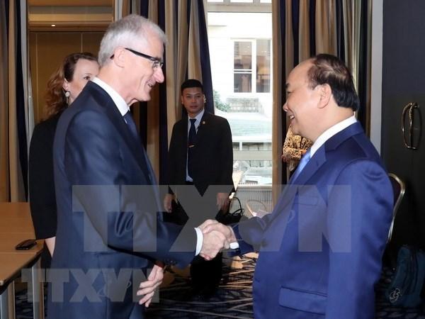 Premier de Vietnam continua sus actividades en Belgica hinh anh 1