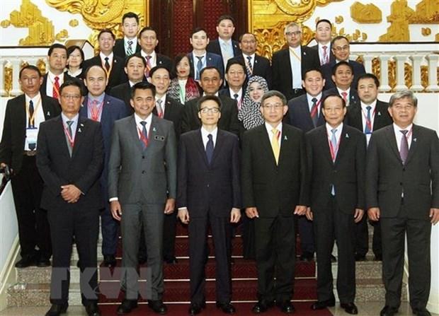 Vicepremier vietnamita recibe a jefes de delegaciones participantes a AMMD-6 hinh anh 1