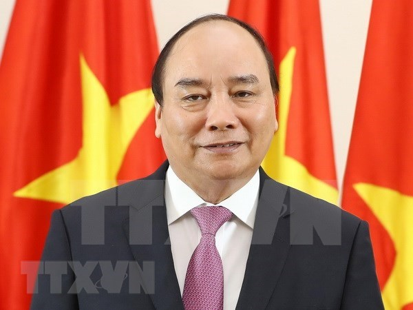 Premier de Vietnam viaja a China para asistir feria internacional de importaciones hinh anh 1