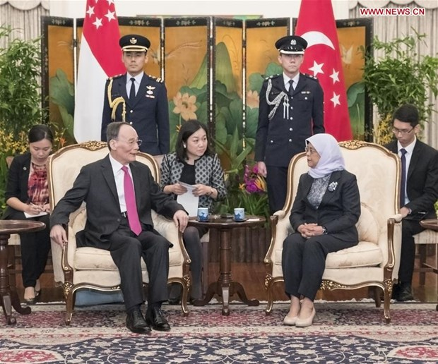 China promete profundizar cooperacion con Singapur y seguir abriendo puertas a inversores hinh anh 1