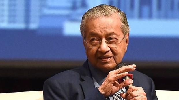 Malasia reafirma respaldo a libre comercio durante Cumbre 26 del APEC hinh anh 1
