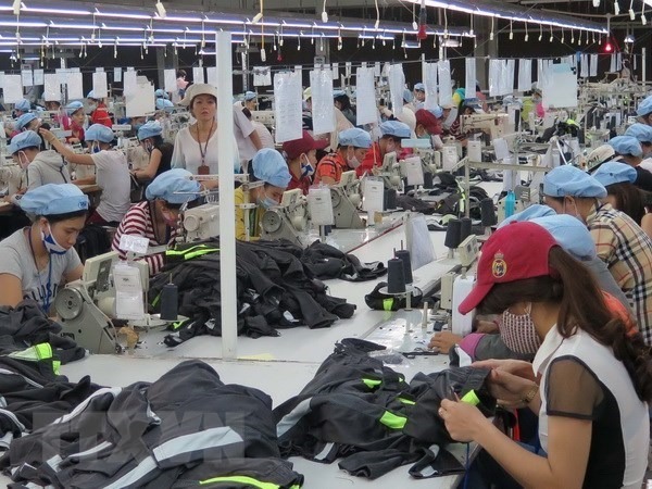 Empresas vietnamitas aprovechan la guerra comercial EE.UU.-China para impulsar exportaciones hinh anh 1