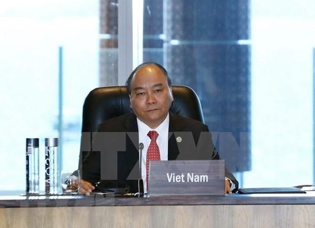 Premier vietnamita concluye amplia agenda en Cumbre 26 del APEC hinh anh 1