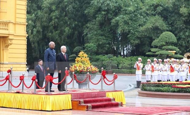 Maximo dirigente politico de Vietnam preside acto de bienvenida al presidente indio hinh anh 1