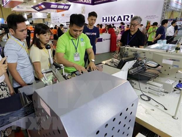 Celebran en Vietnam exposiciones internacionales de calzado y confeccion textil hinh anh 1