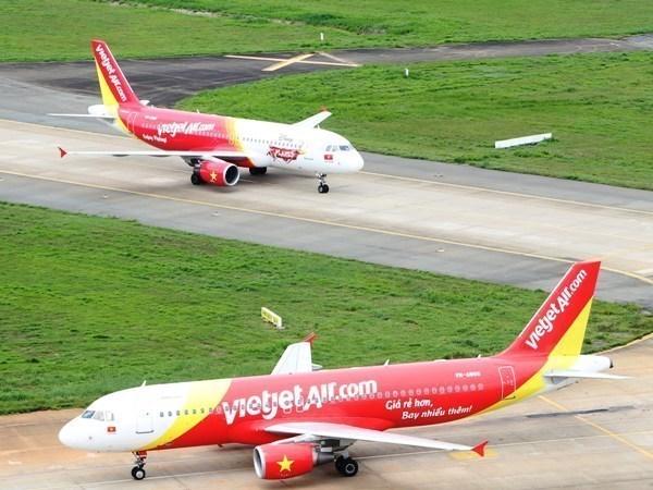 Vietjet Air reajusta operacion de vuelos por tifon Usagi hinh anh 1