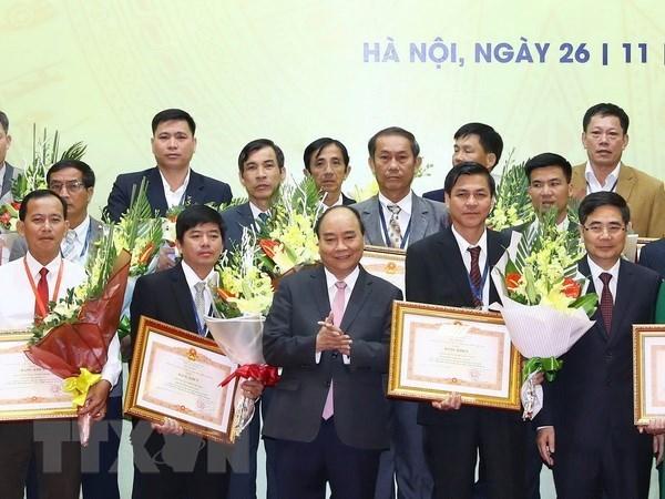 Vietnam honra a individuos y organizaciones destacados en desarrollo agricola hinh anh 1