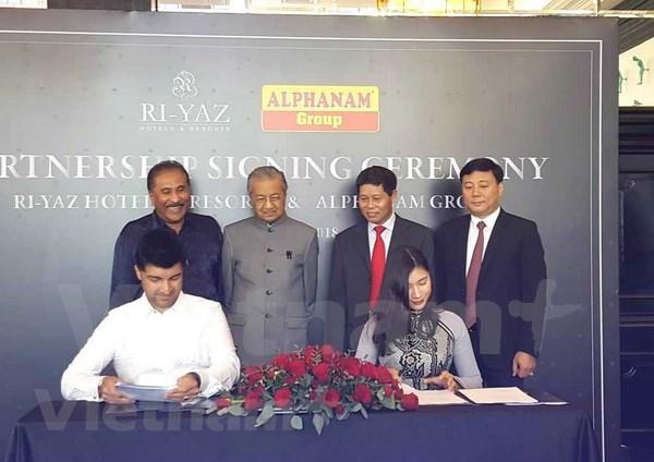 Grupos vietnamita y malasio firman acuerdo de cooperacion en sector hotelero hinh anh 1