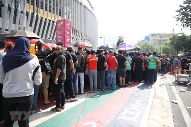 Hinchas formas largas filas por entradas para la final entre Vietnam y Malasia hinh anh 1