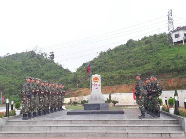 Vietnam y Laos cooperan en la garantia de seguridad en la frontera comun hinh anh 1