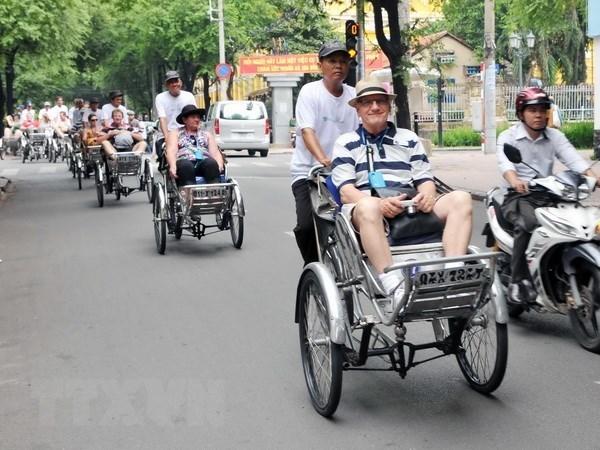Ciudad Ho Chi Minh recibe a turista numero siete millones hinh anh 1