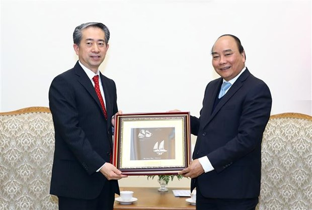 Premier de Vietnam aboga por fortalecimiento de relaciones con China y Dinamarca hinh anh 1