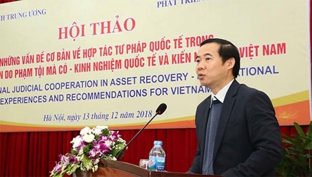 Debate en Vietnam cooperacion en recuperacion de activos derivados del delito hinh anh 1
