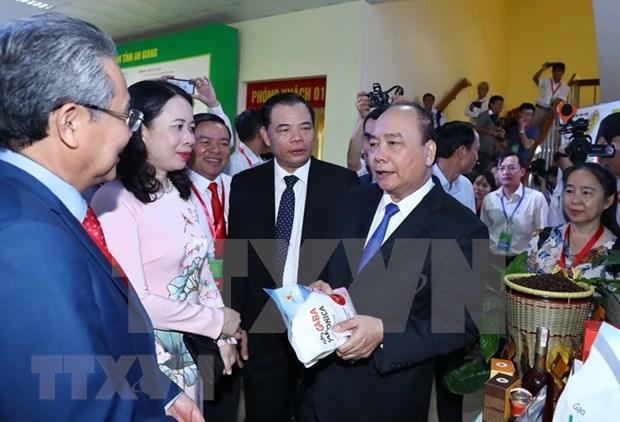 Premier participa en Feria de Promocion de Inversion en An Giang hinh anh 1
