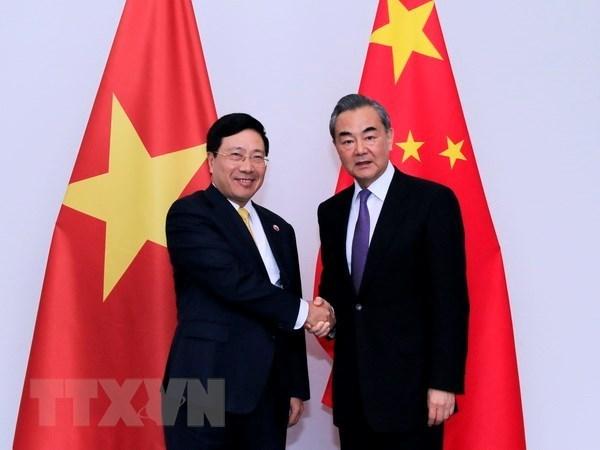 Ministros de Relaciones Exteriores de Vietnam y China se reunen en Vientiane hinh anh 1