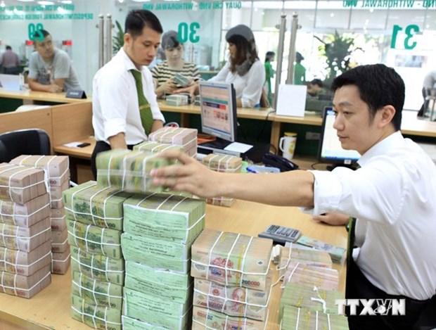 Mercado monetario de Vietnam sufre leves impactos de elevacion de tasa de interes del FED hinh anh 1