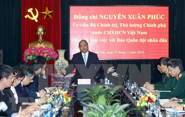Premier de Vietnam resalta contribucion del periodico Ejercito Popular a lucha contra corrupcion hinh anh 1