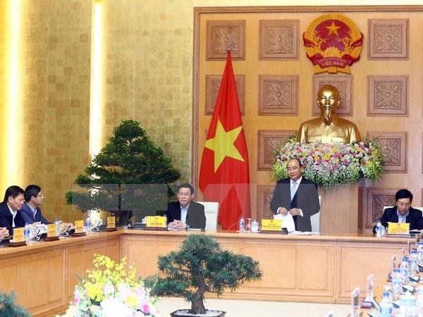 Premier vietnamita mantiene reunion de trabajo con asesores economicos hinh anh 1