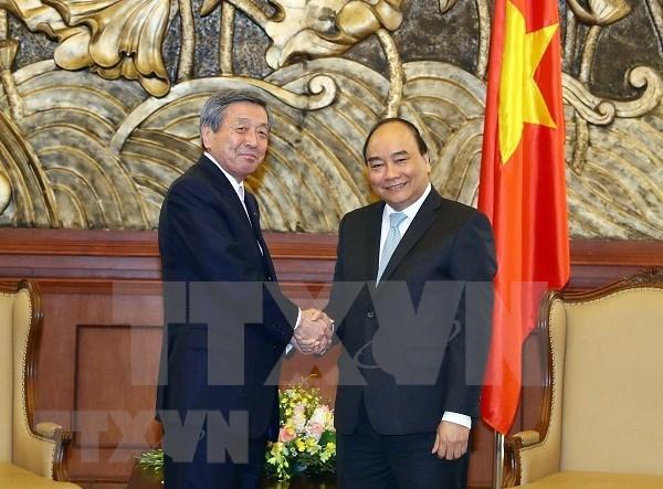 Premier vietnamita pide al Partido Liberal Democratico de Japon a fomentar lazos con su pais hinh anh 1