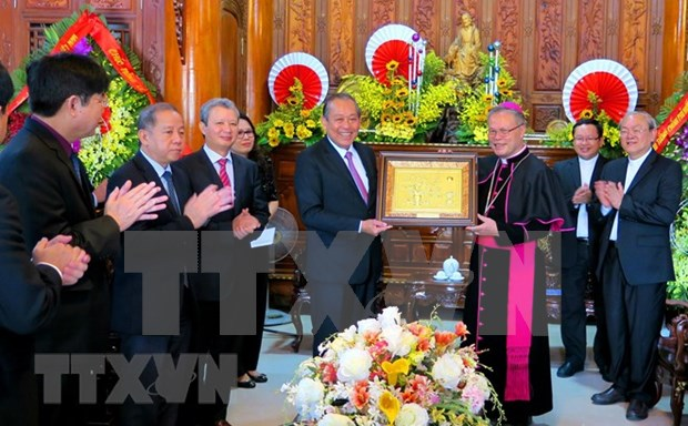 Dirigentes de Vietnam felicitan a comunidad catolica por Navidad 2018 hinh anh 1