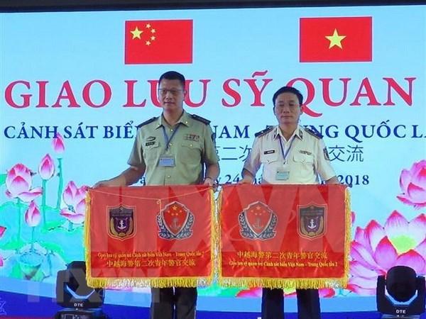Efectuan programa de intercambio entre fuerzas de guardia costera de Vietnam y China hinh anh 1