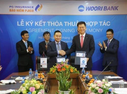 Compania de seguros de Vietnam coopera con banco surcoreano hinh anh 1