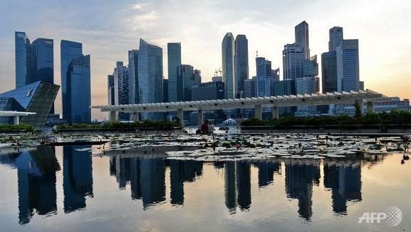 Economia de Singapur crece menos de lo esperado hinh anh 1