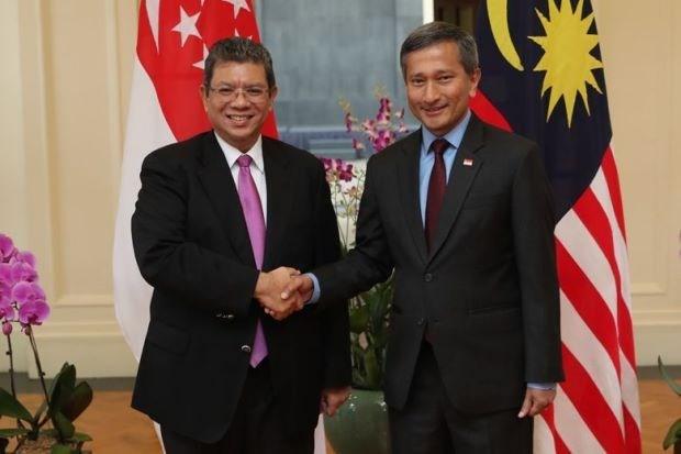 Singapur y Malasia acuerdan medidas para aliviar las tensiones aereas y maritimas hinh anh 1