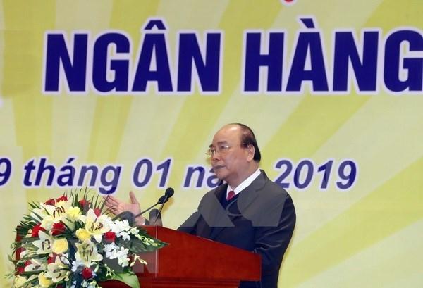 Premier vietnamita urge al sector bancario a aplicar politica monetaria efectiva hinh anh 1