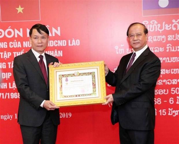 Agencia Vietnamita de Noticias recibe ordenes nobles de Laos hinh anh 1