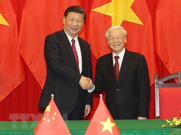 Dirigentes intercambian felicitaciones por aniversario de relaciones Vietnam-China hinh anh 1