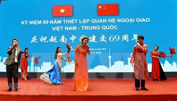 Conmemoran en Beijing aniversario 69 de nexos diplomaticos Vietnam-China hinh anh 1