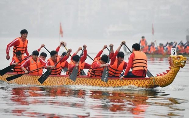 Celebraran regata tradicional del barco de dragon en Hanoi hinh anh 1