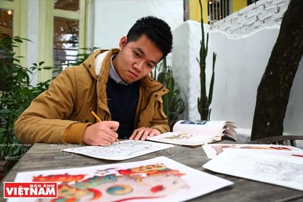 Pintor vietnamita se esfuerza por restaurar pinturas folcloricas tradicionales hinh anh 1
