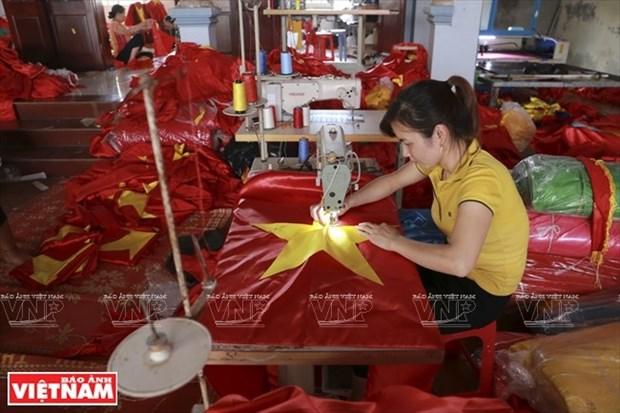 Antigua aldea dedicada a la confeccion de la bandera nacional hinh anh 1