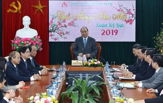 Premier vietnamita exhorta a Banco de Politicas Sociales a empenarse en reducir la pobreza hinh anh 1