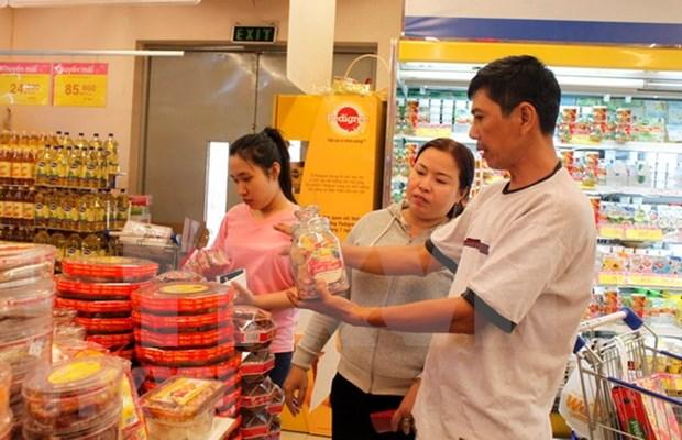 Empresas vietnamitas firmes en camino de conquistar confianza de consumidores hinh anh 1