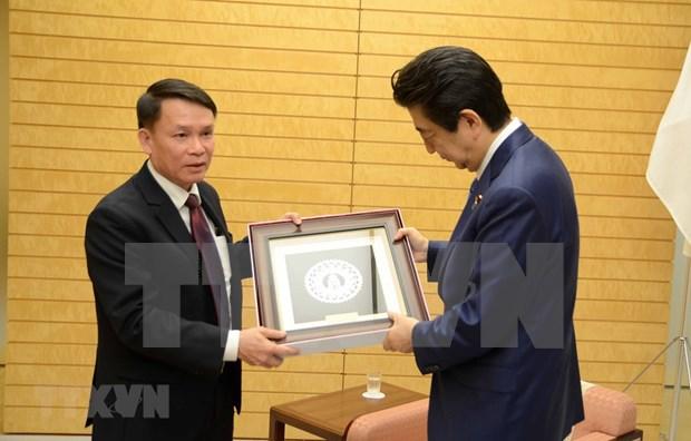 Realiza delegacion de la Agencia Vietnamita de Noticias visita a Japon hinh anh 1