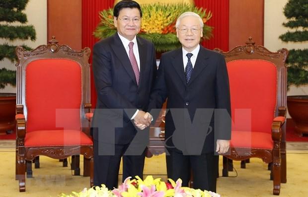 Fortalecera visita a Laos de maximo dirigente de Vietnam relaciones bilaterales hinh anh 1