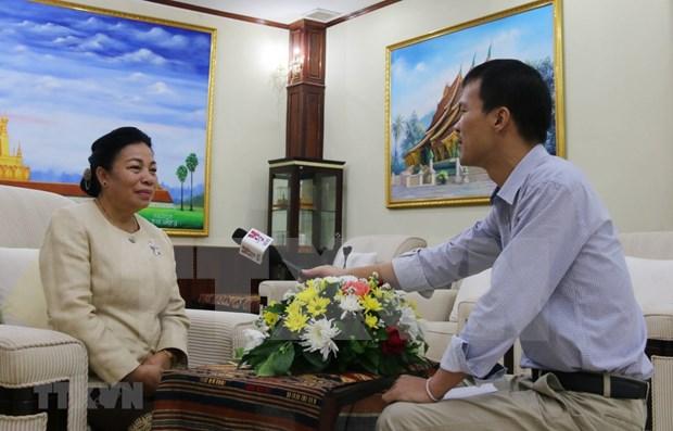 Impulsara visita del maximo dirigente vietnamita a Laos los nexos bilaterales hinh anh 1