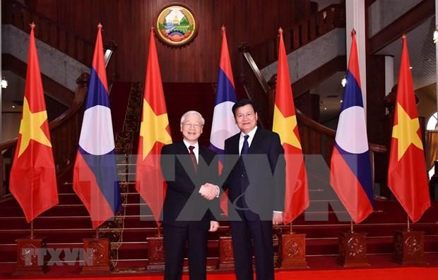 Maximo politico vietnamita se reune con dirigentes laosianos hinh anh 1