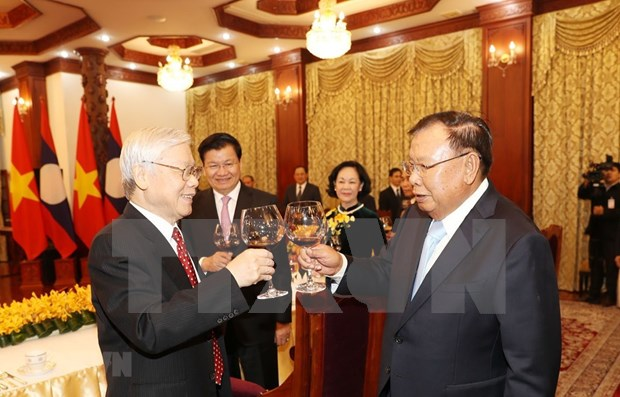 Ratifican relaciones de gran amistad y solidaridad especial entre Vietnam y Laos hinh anh 1