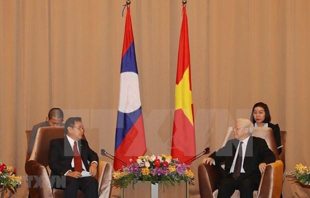 Concluye maximo dirigente vietnamita visita oficial a Laos hinh anh 1
