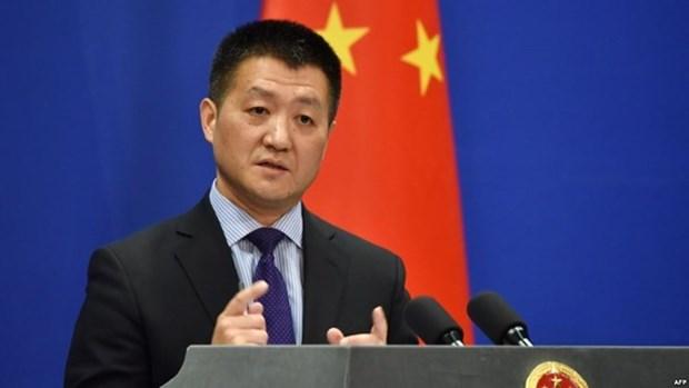 Dialogo y consulta son unica forma de resolver el problema en peninsula coreana, afirma vocero chino hinh anh 1