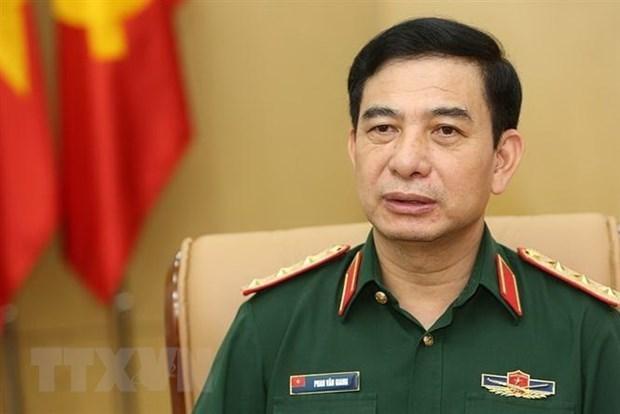 Delegacion militar de alto nivel de Vietnam visita Singapur y Japon hinh anh 1