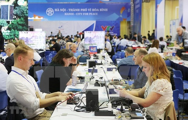 Segunda Cumbre EE.UU.-RPDC, ocasion para que reporteros internacionales conozcan la cultura vietnamita hinh anh 1