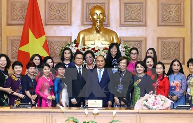 Premier destaca papel de mujeres al desarrollo nacional hinh anh 1