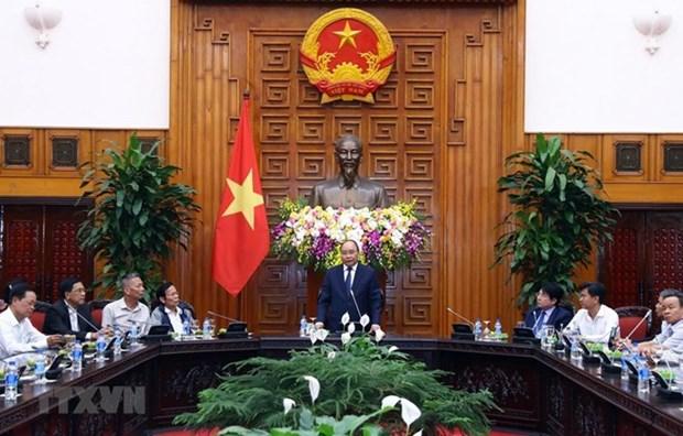 Premier vietnamita se reune con personas con meritos revolucionarios de ciudad central de Da Nang hinh anh 1