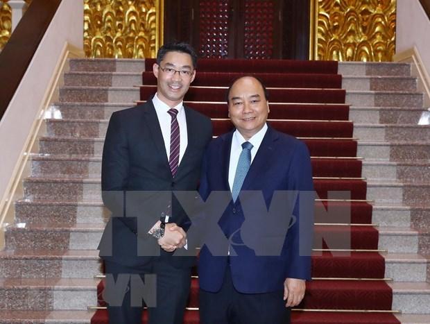Sostuvo primer ministro vietnamita sostuvo encuentro con el economista Philipp Rosler hinh anh 1
